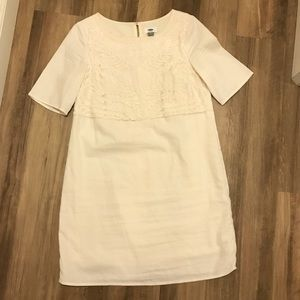 White dress with embroidered top